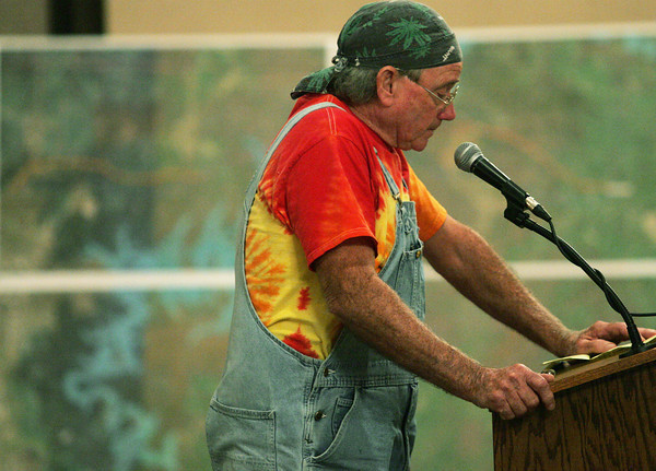 Globe/Roger Nomer<br /> Joe Foust, Eureka Springs, Ark., pauses to collect himself during his testimony against the power lines at Monday's hearing at the Inn of the Ozarks Conference Center.