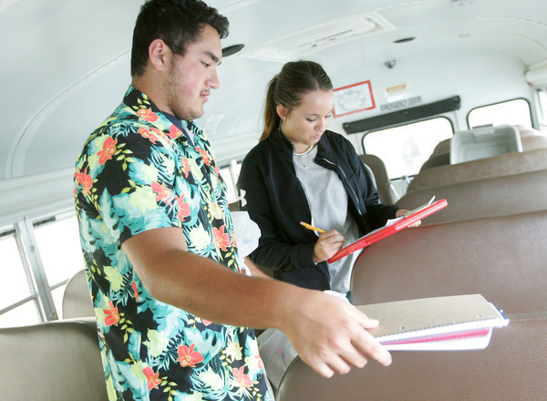 Globe/Roger Nomer<br /> Carl Junction High FBLA members Zach Beyer, senior, and Caroline Adams, senior, FBLA vice president, help sort school supplies for the Stuff the Bus event at the Seventh Street Wal-Mart on Friday.  Bright Futures is collecting school supplies at Wal-Mart locations this weekend and next weekend for Joplin, Carl Junction and Webb City schools.