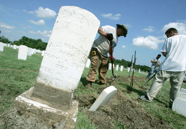 Globe/Roger Nomer<br /> (from left) Tony Ragan, Muskogee, Okla., Adam Schiew, Ft. Gibson, Okla., and Mitchell Greenwalt, Tulsa, Okla., work on headstones at the Baxter Springs cemetery on Tuesday morning.