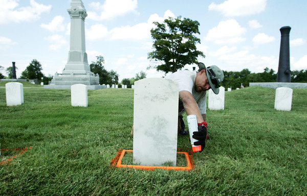 Globe/Roger Nomer<br /> Tony Ragan, Muskogee, Okla., marks the base of a gravestone at the Baxter Springs cemetery on Tuesday.