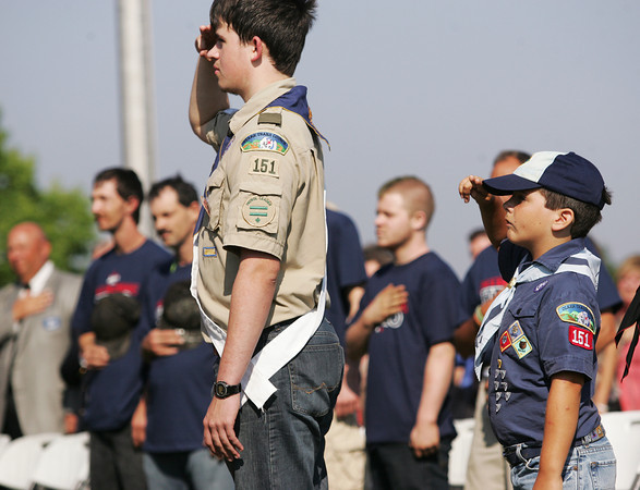Globe/Roger Nomer<br /> Troop and Pack 151 scouts Josh Katzer, 16, and Dakota Reese, 9, salute the flag during the opening of Jake's Fireworks in Pittsburg on Monday morning.