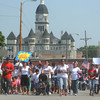 Globe/Roger Nomer<br /> Participants wave flags and signs along the parade route in Carthage on Thursday morning.  Area Hispanic churches organized the holiday parade.