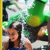 Globe/T. Rob Brown<br /> Sarah McNeil, 11, of Cement, Okla., gets splashed by a water playground frog Tuesday afternoon, July 9, 2013, at Parr Hill Park. The park, which had been closed for lead remediation, is now again open to the public.