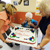Globe/T. Rob Brown<br /> Eunice Lewis, 100, of Granby, takes a small taste of her birthday cake Monday afternoon, July 8, 2013, at the Granby House. Her cake was delivered by Granby House Administrator Misty Shepherd (left) and Tammy Sherwood, activities director. Lewis, who served in the U.S. Women's Army Corps from Sept. 1, 1943, to Dec. 16, 1945, is one of the oldest living WACs and received the American Theater Campaign Medal and the Good Conduct Medal.