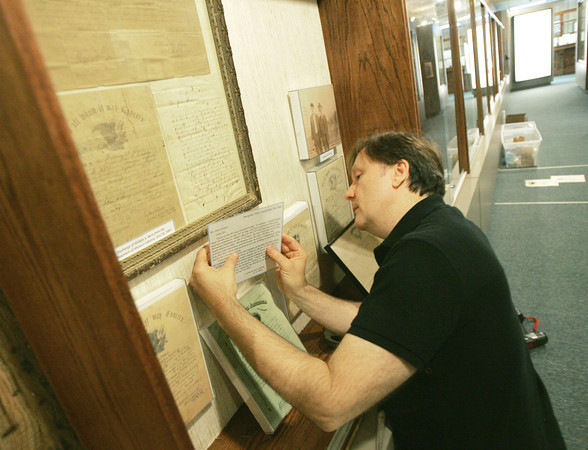 Globe/Roger Nomer<br /> Brian Rardin sets up an exhibit on the Civil War at the Baxter Springs History Museum on Tuesday afternoon.