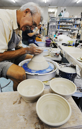 """Globe/T. Rob Brown<br /> Mark Oehler of Reeds Spring creates several bowls for the """"Empty Bowl-a-Thon"""" Thursday morning, July 18, 2013, at Phoenix Fired Art in Joplin. Clay wielders set a goal of 1,000 bowls to be sold in November during the Empty Bowl fundraiser."""