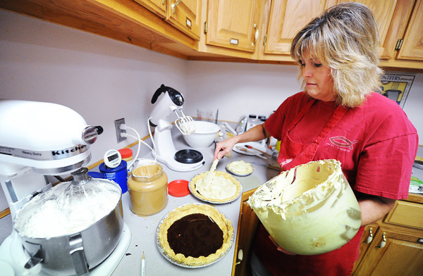 Globe/T. Rob Brown<br /> Volunteer Kathy Cowley makes peanut butter and chocolate pies at Byers Avenue United Methodist Church for the Fall Fiasco Pie Sale Wednesday afternoon, July 3, 2013.