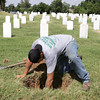 Globe/Roger Nomer<br /> Adam Schiew, Ft. Gibson, Okla., digs out a base of a gravestone at the Baxter Springs cemetery on Tuesday.