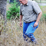 Globe/T. Rob Brown Kevin Badgley, community outreach specialist with the Missouri Department of Conservation, said tall grass is a common place to pick up ticks Friday morning, July 26, 2013 ...