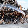 Globe/T. Rob Brown<br /> Cleanup begins Wednesday afternoon, July 24, 2013, on the collapsed building on Main Street near the intersection with 9th Street.
