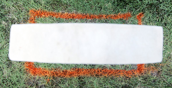 Globe/Roger Nomer<br /> An orange rectangle marks the base of a gravestone at the Baxter Springs cemetery.