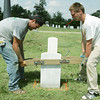 Globe/Roger Nomer<br /> Adam Schiew, Ft. Gibson, Okla., left, and Mitchell Greenwalt, Tulsa, Okla., strain to unearth a gravestone at the Baxter Springs cemetery.