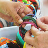 Globe/Roger Nomer<br /> Helping Hands, a group dedicated to raising money to support tornado victims in Little Axe, Okla., sold a variety of bracelets during Fourth of July festivities at Landreth Park.