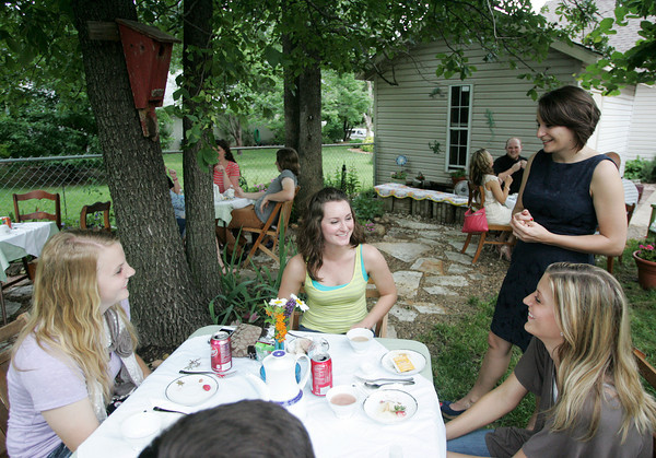 Globe/Roger Nomer<br /> Missouri Southern students (from left) Natalie Fox, Carl Junction sophomore, Hailey Bush, Neosho junior, Britni Stanley, Kansas City senior, and Courtney Caldwell, Carl Junction senior, chat during an English Tea Party on Thursday for returning students who visited Europe this summer.