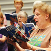 Globe/T. Rob Brown<br /> Choral Society member Leecia Bloss (right) of Joplin practices Monday evening, July 22, 2013, for the society's Patriotic Concert at First Baptist Church in Webb City. The event, scheduled for 3 p.m. Sunday, July 28, is sponsored by Missouri Southern State University's Department of Music in cooperation with the Division of Lifelong Learning.
