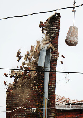 Globe/T. Rob Brown<br /> A wrecking crew brings down the remains of the collapsed building on Main Street Monday afternoon, July 29, 2013, near the intersection with 9th Street in Joplin.