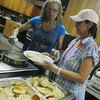 Globe/Roger Nomer<br /> Rayma Martin, left, and Candy Peew serve breakfast during a fundraiser for Tommy Moore at the Joplin Masonic Lodge on Saturday morning.  Friends and family are holding a series of fundraisers for Moore, who was recently diagnosed with Acute Lymphobastic Leukemia, to help with medical expenses.  The next fundraiser will be a rummage sale and spaghetti dinner at First Family Christian Church's Lighthouse in Carthage on July 27th.