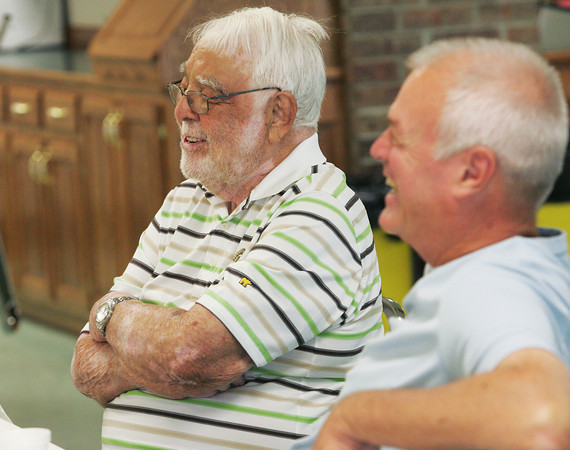 Globe/Roger Nomer<br /> Former mayors Larry Hickey, left, and Darius Adams chat during a reunion Friday at Central Christian Church.