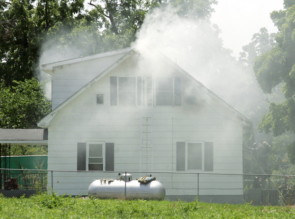 Globe/Roger Nomer<br /> Firefighters from Webb City and Carterville respond to a structure fire near Ivy Road and D Highway in Oronogo on Thursday afternoon.