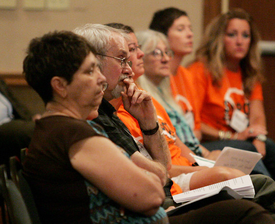 Globe/Roger Nomer<br /> Eureka Springs residents watch testimony at Monday's hearing at the Inn of the Ozarks Conference Center.