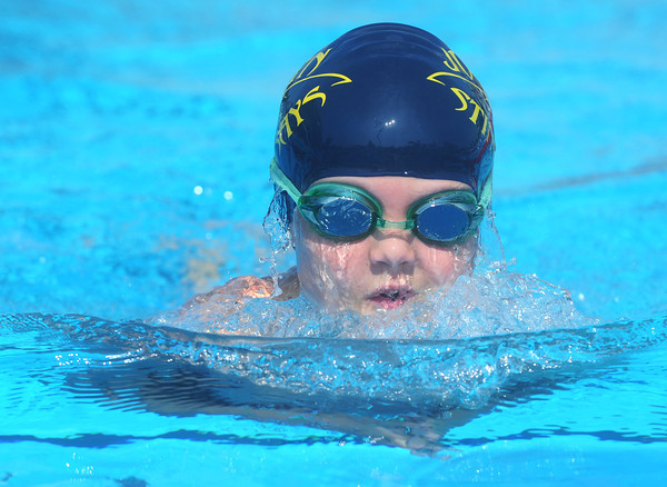 Globe/Roger Nomer<br /> Water streams off of Colter Camp, 8, as he practices his butterfly stroke with the Joplin Stingrays swim club at Schifferdecker Pool on Friday morning.  The Stingrays will host the Tri-State Swim Conference swim meet next weekend at the pool.