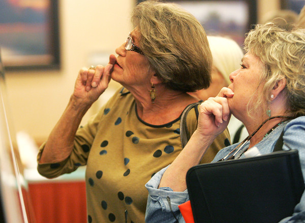 Globe/Roger Nomer<br /> Anita Taylor, Holiday Island, Ark., left, and Janice Murray, Berryville, examine a map of proposed power lines at Monday's hearing at the Inn of the Ozarks Conference Center.
