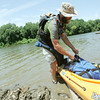 Globe/Roger Nomer<br /> Will Hembree unloads his kayak at Twin Bridges State Park on Tuesday after completing his journey.