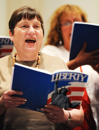 Globe/T. Rob Brown<br /> Choral Society member Martha Tilton (left) of Carthage practices Monday evening, July 22, 2013, for the society's Patriotic Concert at First Baptist Church in Webb City. The event, scheduled for 3 p.m. Sunday, July 28, is sponsored by Missouri Southern State University's Department of Music in cooperation with the Division of Lifelong Learning.