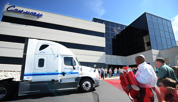 Globe/T. Rob Brown<br /> Bill Compton, a Con-way Truckload driver operates his tractor through a ribbon in front of the company's Joplin headquarters Wednesday morning, July 17, 2013. Compton has logged 4 million miles with Con-way and CFI.