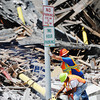 Globe/T. Rob Brown<br /> Cleanup begins by removing a damaged light pole Wednesday afternoon, July 24, 2013, on the collapsed building on Main Street near the intersection with 9th Street.