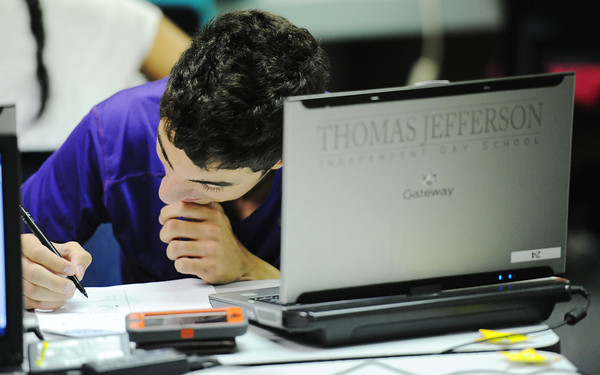 Globe/T. Rob Brown<br /> Thomas Jefferson Independent Day School sophomore Michael Joseph takes a practice SAT Monday afternoon, July 29, 2013, in a school computer lab.