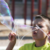 Globe/Roger Nomer<br /> Jonah Solomon, 10, works on constructing a monster bubble during Art Feeds' Science and Art Collide Workshop at Irving Elementary on Tuesday morning.