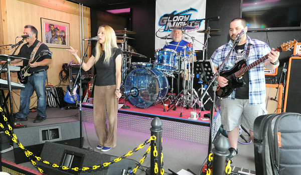 From the left: Glory Days Band members David Peterson, Buffy Peterson, Ben Peterson and Benji Peterson rehearse Wednesday morning at the music store on North Range Line.<br /> Globe | Laurie Sisk