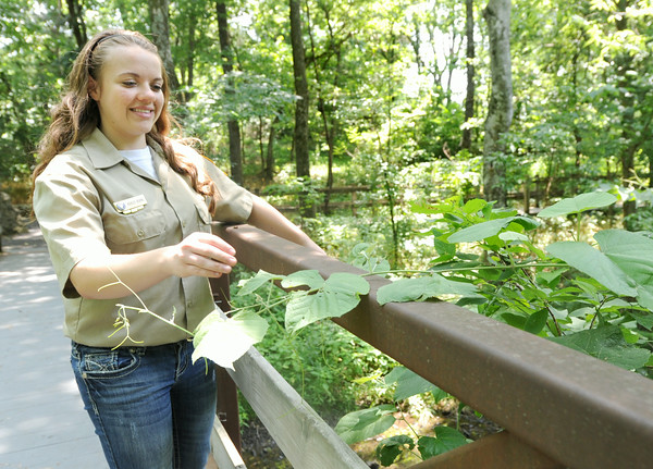 George Washington Carver National Park volunteer Ashley Burns clears overgrowth from walkways on Wednesday at the park. Burns said she enjoys being a part of keeping Carver's memory alive.<br /> Globe | Laurie Sisk