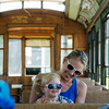 Globe/Roger Nomer<br /> Jessica Isenberger and her daughter Dovelyn, 2, Neosho, prepare for a ride on the Street Car #60 on Thursday in King Jack Park.