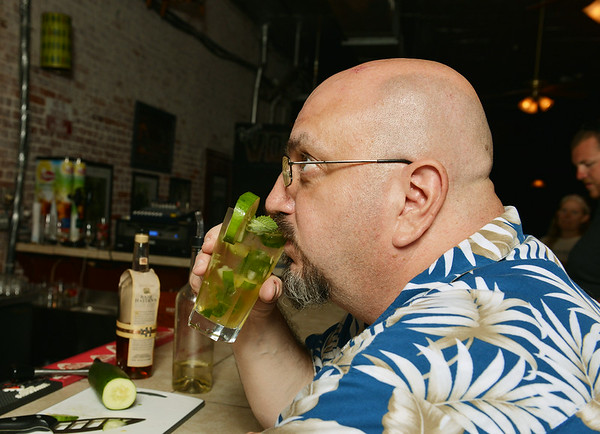 Globe/Roger Nomer<br /> John Oberley takes a test sip of a mint julep at Palace Pizza on July 1, 2014.