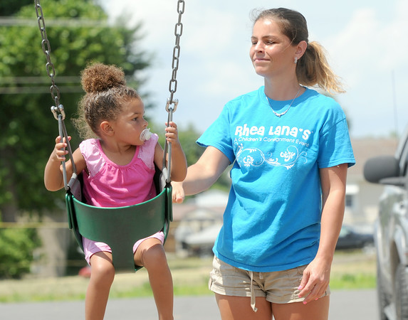 Brandy Phillips swings her daughter, three-year-old Samarie Perry during an afternoon at Cunningham Park on Monday.<br /> Globe | Laurie Sisk