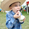 Six-year-old Remington Daniels, Chanute,  enjoys a pineapple whip on Friday at the Four States Farm Show in Pittsburg.<br /> Globe | Laurie Sisk