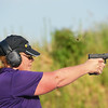 Globe/Roger Nomer<br /> Mary Bryant takes target practice with a hand gun during A Girl and a Gun shooting club on Tuesday evening.