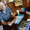 "Globe/Roger Nomer<br /> Vinita author David Peace talks about his book ""Jungle Pack Therapy Workbook and Journal"" during a signing at College Station Daylight Donuts and Coffee on Monday morning. The book draws on Peace's experience as a therapist, and functions as journal for self exploration."