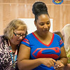 Globe/Roger Nomer <br /> Soroptimist member Shelly Goerz, left, and Kelly Sales, court administrator for Jasper County, talk with a camper during Camp Soroptimist on Tuesday.