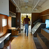 Globe/Roger Nomer<br /> Darin Tilton walks the length of the railcar on Monday afternoon.