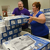 Globe/Roger Nomer<br /> Monica Bailey, community outreach coordinator, and Wes McGuirk, regional director, stack box fans at Oxfod HealthCare on Thursday. The donated fans were distributed to seniors in need. Remaining box fans will be made available to seniors again at a later date.