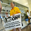 Globe/Roger Nomer<br /> Laura Umphenour, Nixa, with Missourians 4 Protection of Animals, sells signs opposing Amendment 1 following an informational meeting at Missouri Southern on Wednesday.