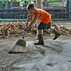 Globe/Roger Nomer<br /> Ethan Brouillard, 4, Carthage, helps seep up the Jasper County Fairground on Monday morning.