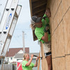 Globe/Roger Nomer<br /> Ashley Popma, 15, Grand Rapids, Mich., works on a house on Kentucky as she volunteers on Wednesday with World Renew Disaster Response Services.