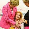Globe/Roger Nomer<br /> Patty Richard, introduces her granddaughter, Natalie Greer, 7, to Kathy Brown after Tuesday's signing of breast density legislation at Freeman Hospital. The two women were credited by Gov. Jay Nixon for helping pass the legislation.