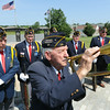 Flanked by fellow veterans of the American Legion, Howard Spiva practices his bugling before a veteran's memorial service on Wednesday at Mount Hope Cemetery.<br /> Globe | Laurie Sisk
