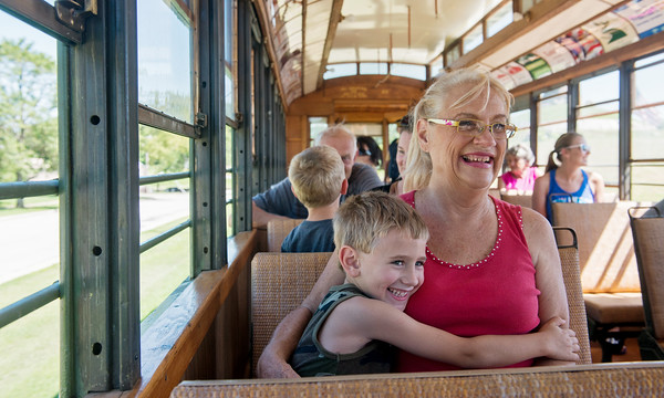 Globe/Roger Nomer<br /> Christian Hirshey, 5, gives his aunt Teressa Hirshey, Carl Junction, an excited hug during a ride on the Street Car #60 on Thursday in King Jack Park.