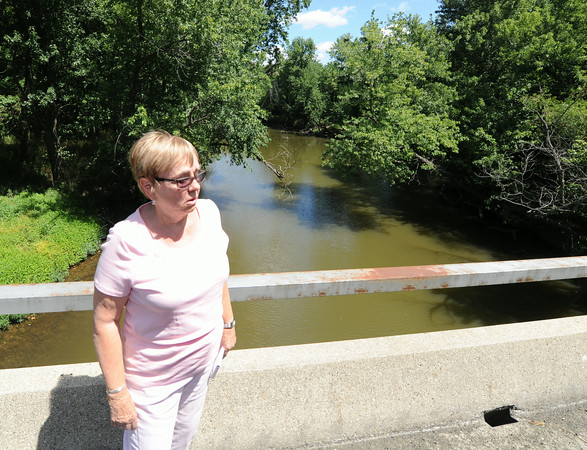 Mariann Jackson, an opponent of a proposed landfill in Riverton, discusses the possible environmental ramifications as she stands near Shawnee Creek on Tuesday. The creek, which runs through the proiposed site, also is a tributary to Spring River, which runs behind Jackson's residence.<br /> Globe | Laurie Sisk